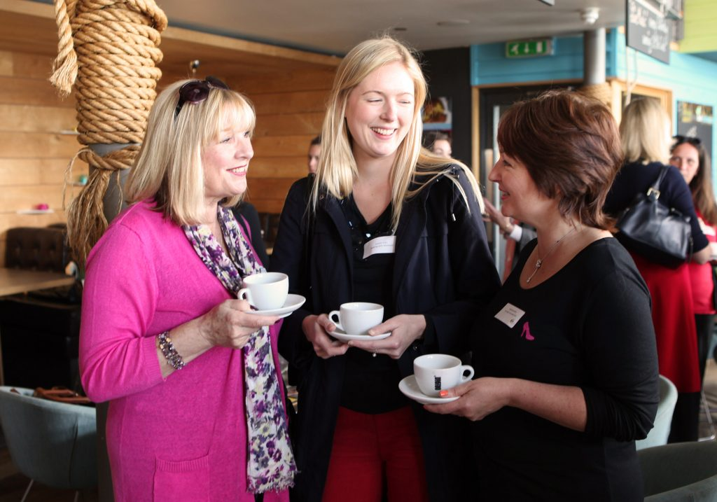 ladies at a DWIB event chatting over coffee